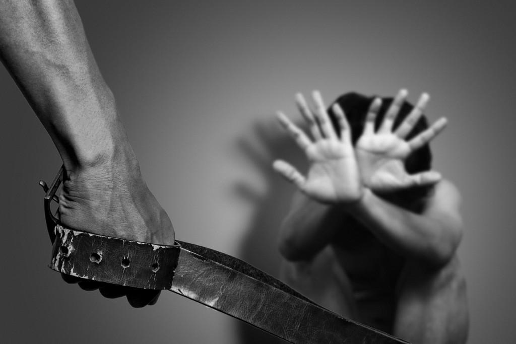 Parent threatening child with belt