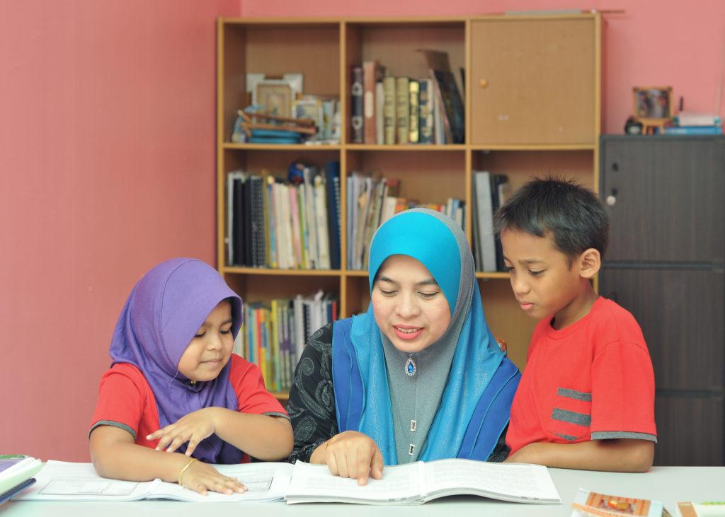 Parent helping kids with homework